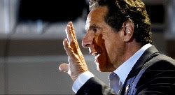 Andrew Cuomo speaking with hand raised