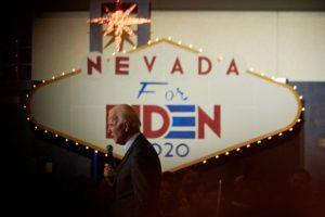joe biden in front of sign that says Nevada for Biden 2020