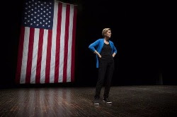 Presidential candidate on stage in front of U.S. flag