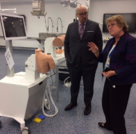 new york senator gustavo rivera touring jacobs school of medicine, looking at medical testing equipment