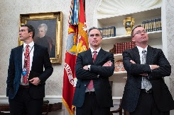 3 men in suits in the Oval Office
