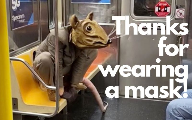 person in rat costume on NYC subway